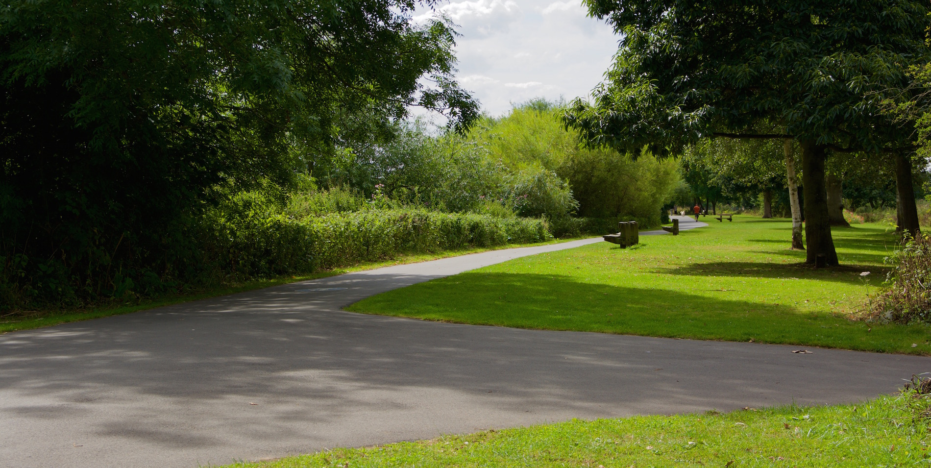 A path leading along the side of the River Severn in Worcester