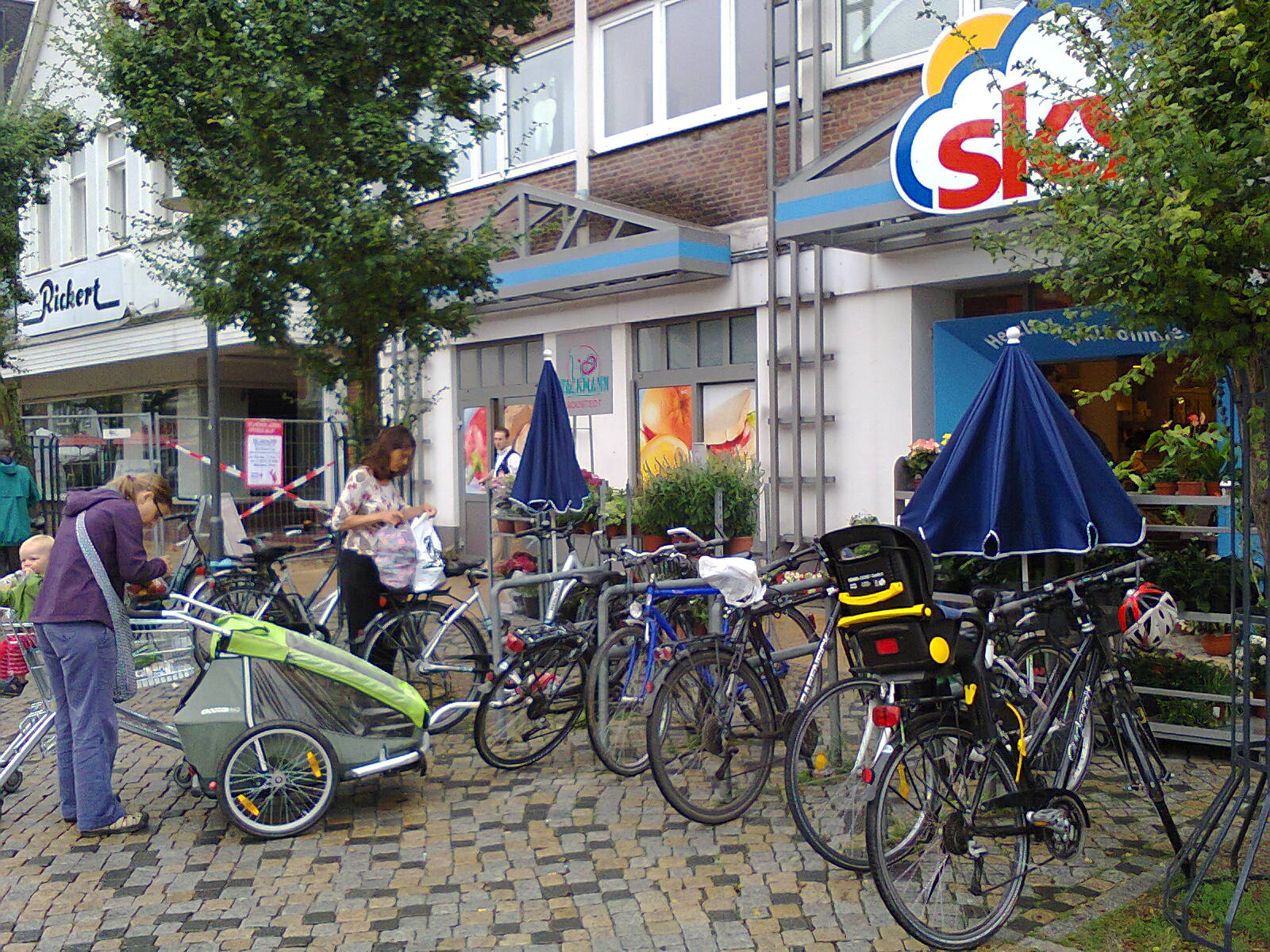 Cycle parking outside a small supermarket