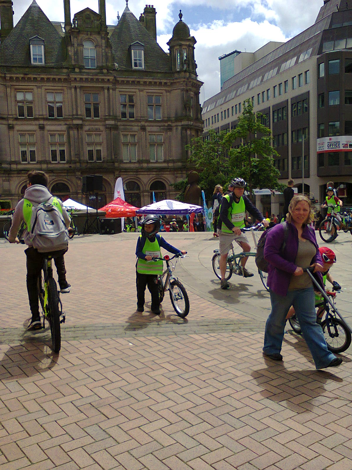 children and adults with bikes