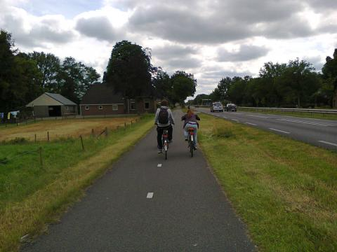 Dutch teenagers riding alongside a main road