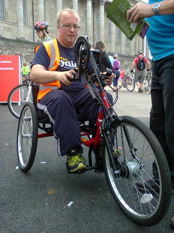 man on hand cycle
