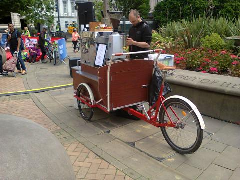 a mobile coffee stand built into a cargo trike