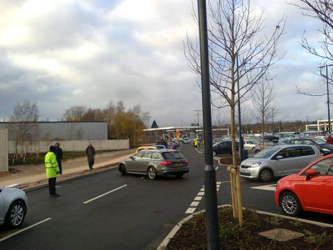Staff control the traffic in the car park at the new Sainsbury's in Selly Oak