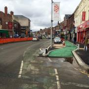 A view of the old and new cycle lanes on the Curry Mile